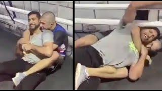 AMIR KHAN GETS REAR NECK CHOKED BY MOKAEV MUHAMMAD!